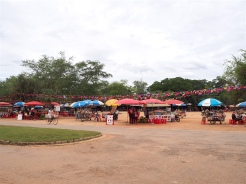 Market stalls outside temple.