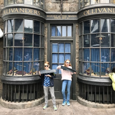 Happy with their new wands from Olivanders