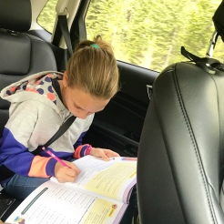Making the most of the journey with some school work.