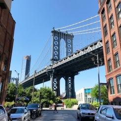 Can you spot the Empire State peeking through under the bridge?